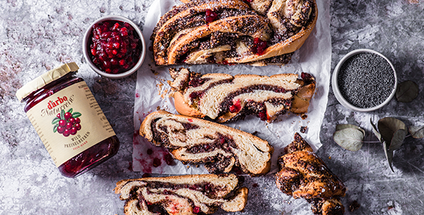 Braided almond and poppy seed cake with wild lingonberries